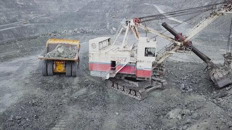 Excavator in an open quarry