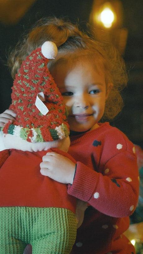 Excited girl with a stuffed Santa Claus