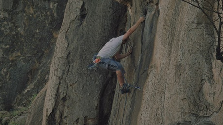 Experienced mountaineer climbing a rocky mountain