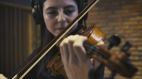 Experienced violinist playing in a recording studio