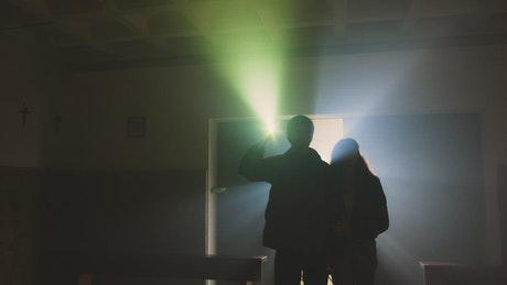Explorers couple in an abandoned church