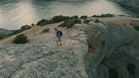 Exploring rocky shoreline and looking at horizon