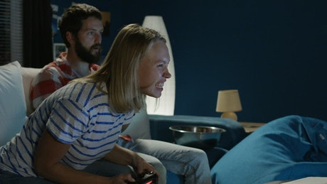 Expressive couple playing video games
