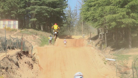 Extreme bikes racing on a dirt track