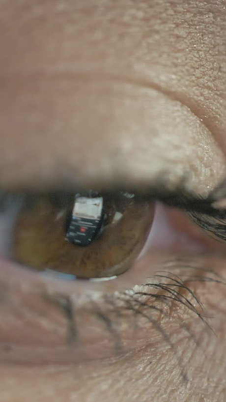 Eye looking at a tablet