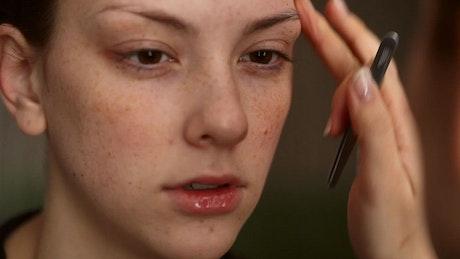 Eyebrows prepartion on model