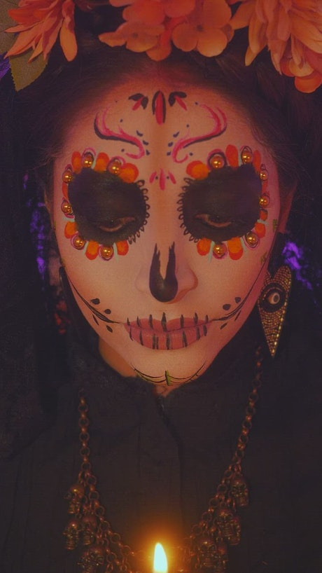 Face of a catrina putting out a candle on the day of the dead