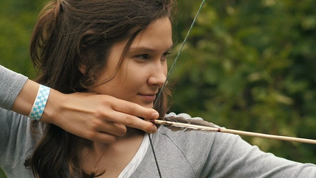 Face of a female archer when shooting an arrow