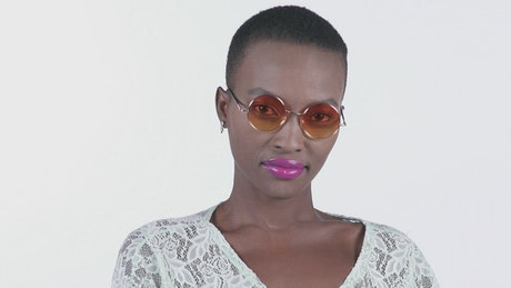 Face of a girl with sunglasses on a white background