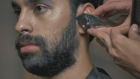 Face of a man while cutting his hair