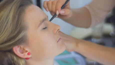 Face of a woman while being made up