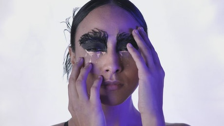 Face of a young ballerina with conceptual makeup
