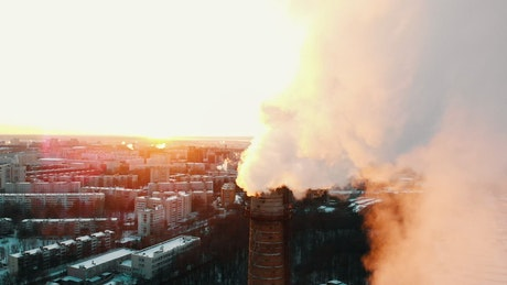 Factory polluting in a city