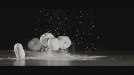 Falling donuts and sugar powder