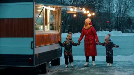 Family at a donut stand after ice skating