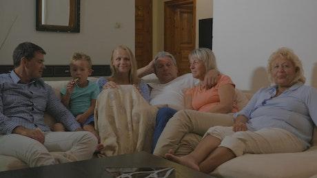 Family celebrating a goal on TV