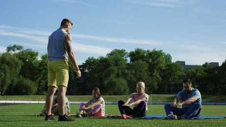 Family doing exercise together in the park
