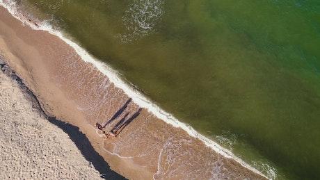 Family enjoying the seashore, aerial shot