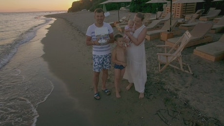 Family flying a drone at the beach