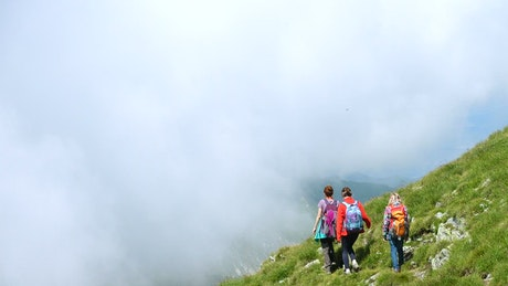 Family hiking in misty mountains