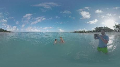 Family in the ocean shown in VR