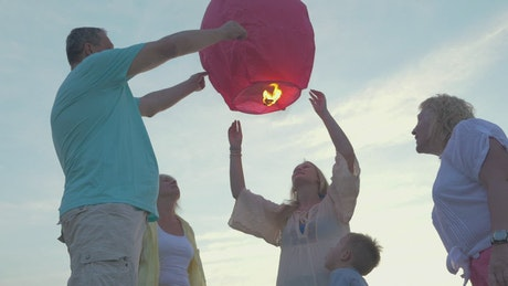 Family launching a lantern