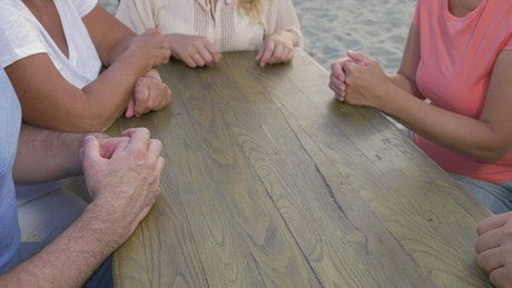 Family making a tower of hands