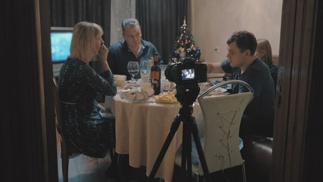 Family recording a meal at Christmas