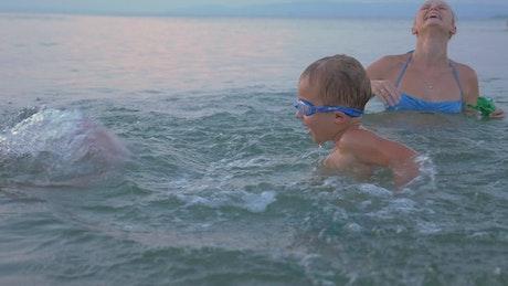 Family splashing in the ocean