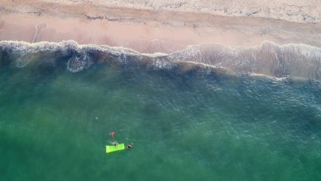 Family swimming in the seashore
