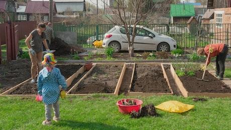 Family taking care of the garden