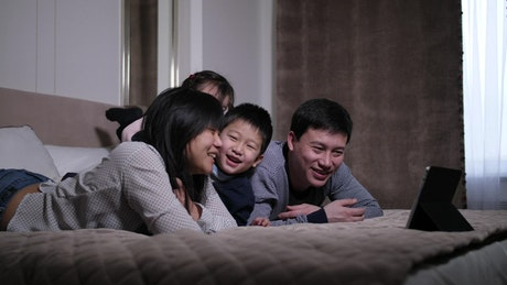Family watch a video together