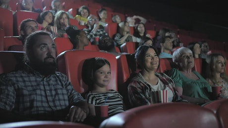 Family watching a film together in a cinema