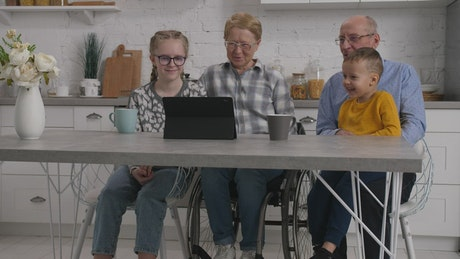 Family watching a funny video