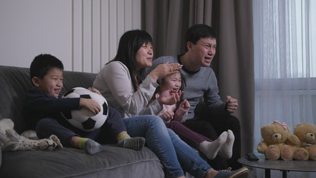 Family watching sport together