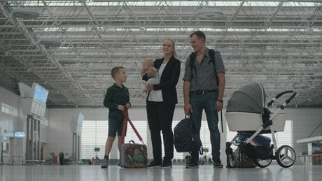 Family with their two kids at an airport