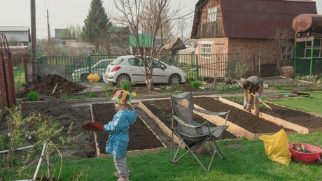 Family working in the garden