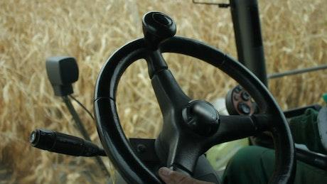 Farmer inside a harvester