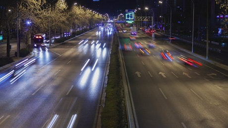 Fast traffic on a Beijing road at night