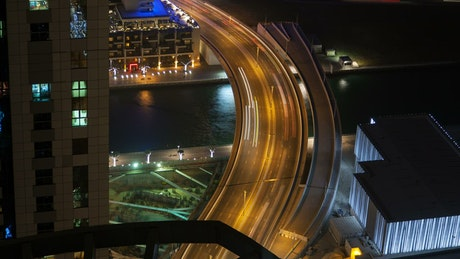 Fast traffic on the highway bridge on Dubai
