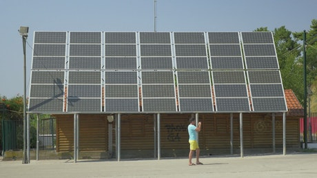 Father and son by a solar array