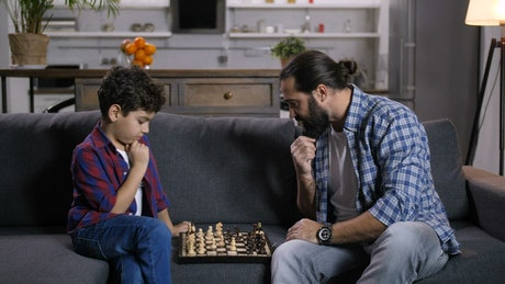 Father and son playing a game