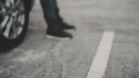 Feet of a person on the pavement