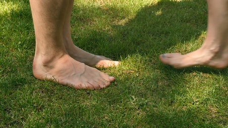 Feet of naked couple kissing