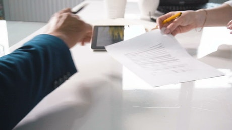 Female boss writes her name on a contract