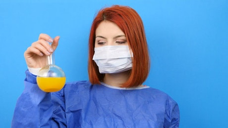 Female chemist confused with liquids from her work