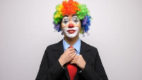 Female clown in suit, portrait