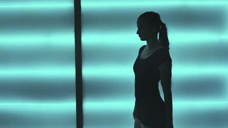 Female contemporary dancer slow dancing in studio