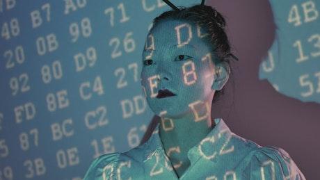Female cyborg being programmed