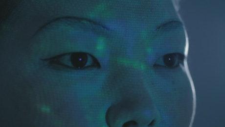 Female cyborg looking to something